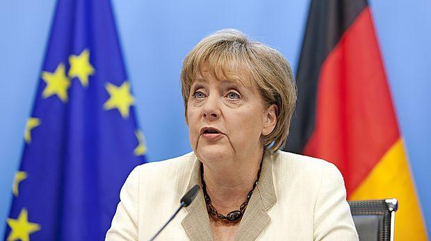 Bundestag Merklovo znova izvolil za kanclerko